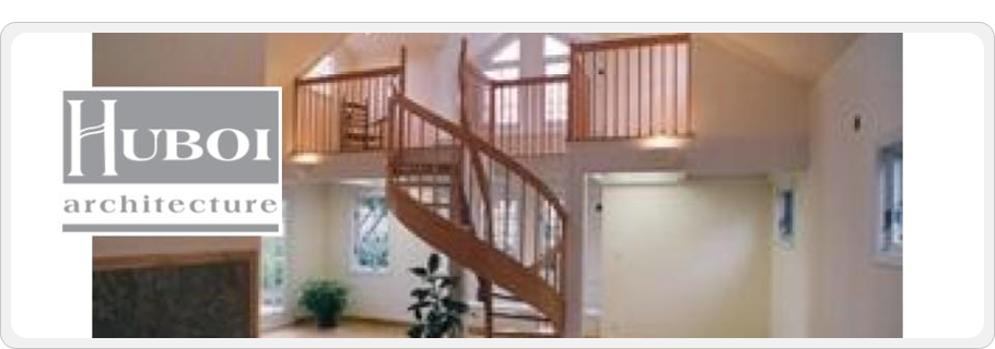 Photo of a stairwell in a home leading from a loft to a lower floor.